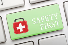 Laptop First aid. Green safety first key on laptop Stock Photo