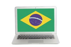 Laptop with Flag of Brazil on screen stock photos