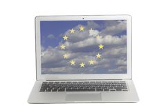 Laptop with Flag of European Union a background of blue sky and clouds on screen royalty free stock photo