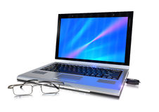 Laptop, flash drive and glasses Royalty Free Stock Photos