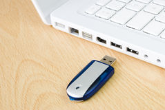 Laptop and flash pen drive Royalty Free Stock Images