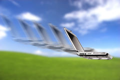 Laptop flying Royalty Free Stock Images