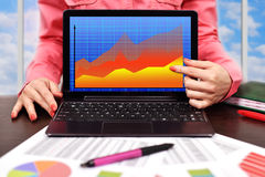 Laptop with forex chart. Businesswoman pointing to laptop with forex chart Royalty Free Stock Images