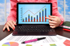 Laptop with forex chart Royalty Free Stock Images