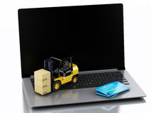 Laptop with Forklift truck. Delivering packages Stock Photos