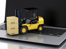 Laptop with Forklift truck. Delivering packages Stock Images
