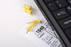 Laptop with a form 1040 Stock Image