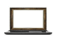 Laptop with a frame for the picture instead of the monitor. Stock Photos