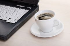 Laptop with fresh cup of coffee and notebook Royalty Free Stock Photography