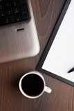 Laptop with fresh cup of coffee Stock Images