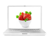 Laptop with fresh strawberry on the screen Stock Image