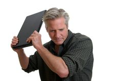 Laptop Frustration. Middle age man expressing frustration with laptop Stock Photo