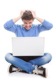 Laptop frustration. Man frustrated with computer Stock Photography