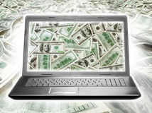 Laptop full of dollars. On money background stock images