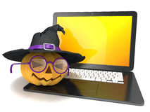 Laptop with funny Jack O Lantern and Halloween witch hat. 3D render Stock Photo