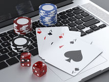 Laptop with gambling chips and poker cards. Isolated on a white background. 3d render Royalty Free Stock Photo