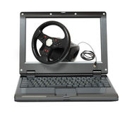 Laptop with gaming car simulator Stock Photo