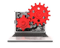 Laptop and gears Stock Image