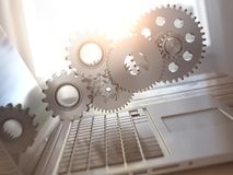 Laptop and gears. Computer technology, online support pc service Stock Image