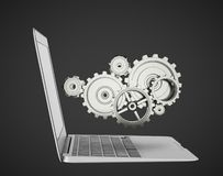 Laptop with gears Stock Image