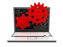 Laptop and gears red Stock Photography
