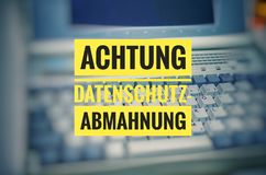 Laptop with in german Achtung Datenschutz-Abmahnung in english attention privacy warning Royalty Free Stock Photo