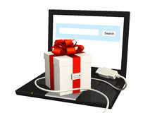 Laptop and gift Stock Photos