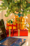 Laptop with gift box and christmas lights Royalty Free Stock Photo