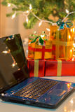 Laptop with gift box and christmas lights Stock Photo