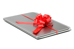 Laptop gift with a red ribbon. Isolated on a white background Stock Photo