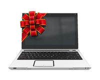Laptop Gift with Red Ribbon Stock Images