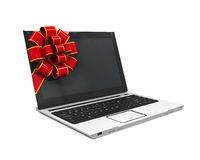 Laptop Gift with Red Ribbon Stock Photography