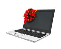 Laptop Gift with Red Ribbon Royalty Free Stock Photography