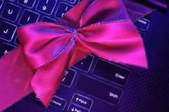 Laptop gift and ribbon stock photography