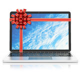 Laptop gift tied with ribbon Stock Images