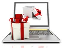 Laptop and gifts Stock Photos