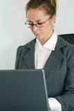 Laptop girl. Young business woman with laptop Royalty Free Stock Image