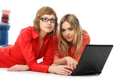 Laptop and girls Royalty Free Stock Images