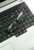 Laptop with glasses Royalty Free Stock Images