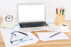 Laptop and glasses brick wall Royalty Free Stock Image