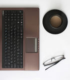 Laptop, Glasses and Coffee on the Table Royalty Free Stock Photography