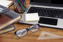 Laptop with glasses and stationery Stock Photo