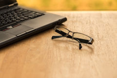 Laptop and glasses Royalty Free Stock Photography