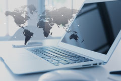 Laptop with globalization concept, technology layer Royalty Free Stock Photos