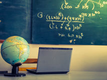 Laptop and globe on table ( Filtered image processed Royalty Free Stock Photo