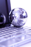 Laptop and globe on white Royalty Free Stock Photo