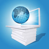 Laptop and globe on white stack of books Stock Photo
