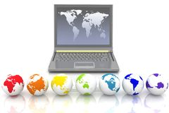 Laptop and globes Royalty Free Stock Photos