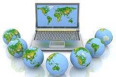 Laptop and globes Stock Photos