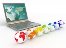 Laptop and globes Royalty Free Stock Image